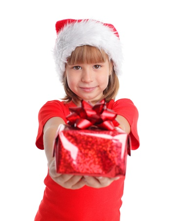 gives: Girl in christmas hat with gift