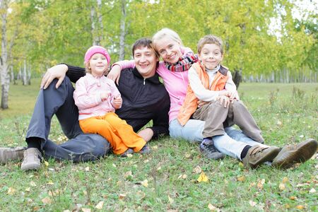 autmn: Happy family with two children in autmn park