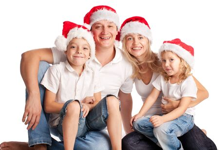 Happiness family in christmas hat isolated on white  photo