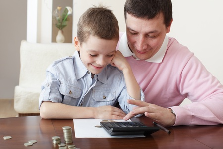 Father training the son to the finance. Series photo