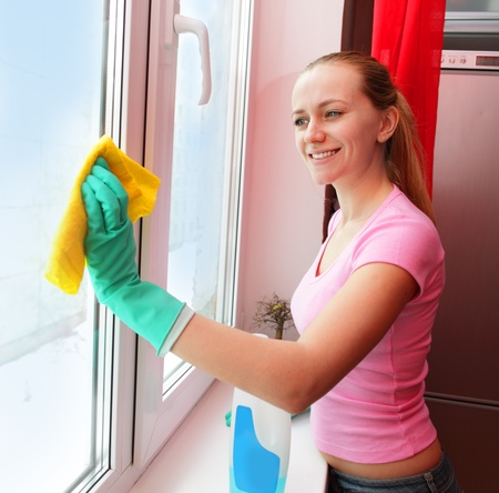 Woman cleaning window at home Stock Photo - 11954597