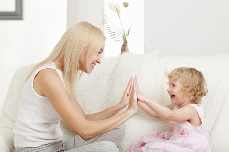 Happy mother with a daughter at home Stock Photo - 11954617