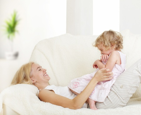 Happy mother with a daughter at home Stock Photo - 11954511