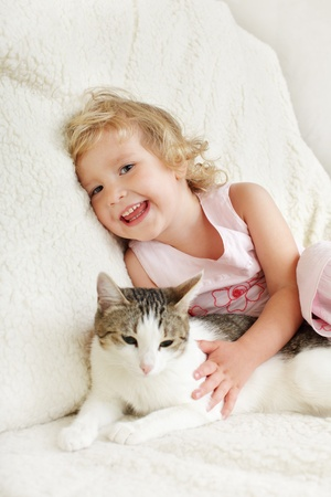 Little happy girl with a cat photo