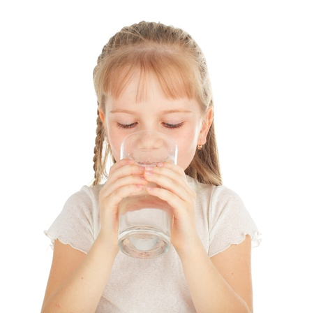Girl with a glass of pure water photo