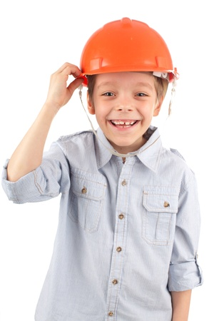 Boy in a building helmet isolated on white photo