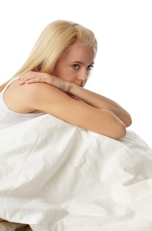 woe: Worried young woman on bed