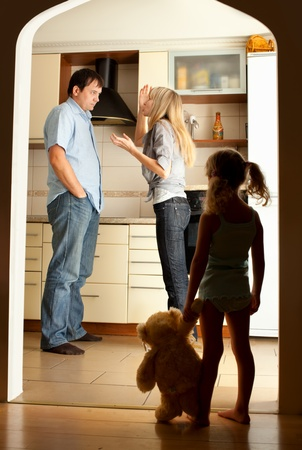 Child looks at the swearing parents Stock Photo - 11954767
