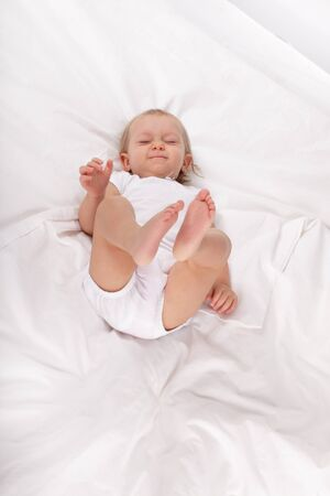 baby bed: Blue-eyed baby in bed