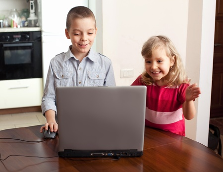 Child with laptop at home Stock Photo - 12157752