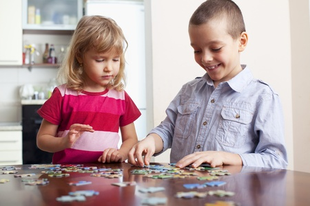 people puzzle: Child, playing puzzles at home