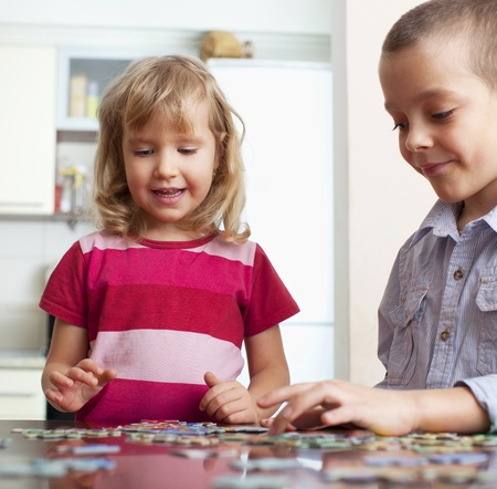 Child, playing puzzles at home photo