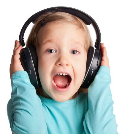 Singing child in headphones isolated on white photo
