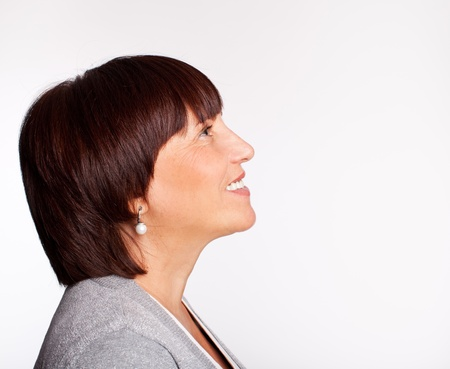 woman face profile: Profile happiness mature woman Stock Photo