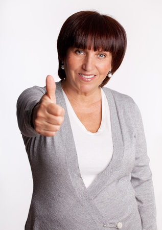 Success and happy mid adult woman photo