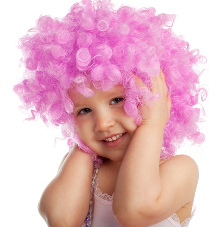 Beautiful little girl in pink wig isolated on white Stock Photo - 12159010