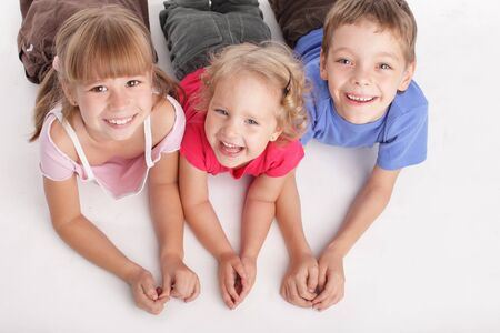 Happy children isolated on a white background photo