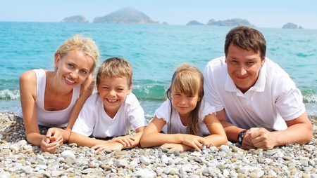 Happy family of four on the beach Stock Photo - 12159368