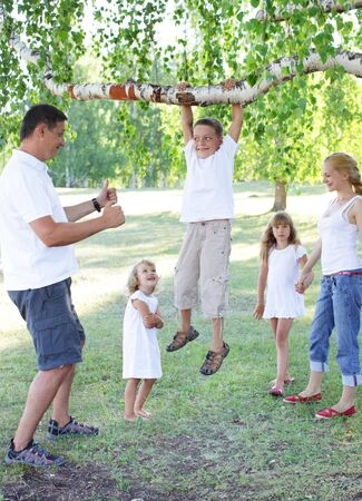 Happy family with children in park photo