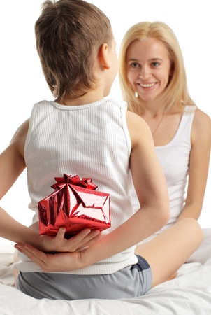 Son gives to mum a gift photo