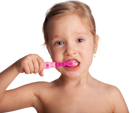 front teeth: Little girl with toothbrush isolated on white Stock Photo
