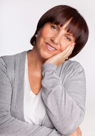 one senior woman only: Portrait happy mature woman looking at camera