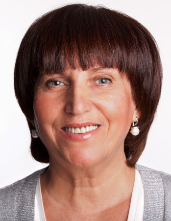 Portrait happy mature woman looking at camera