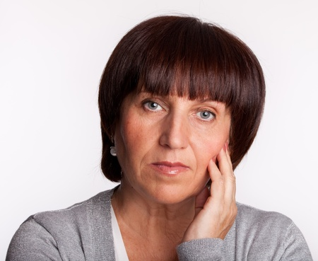 one senior woman only: Mid serious adult woman. Portrait