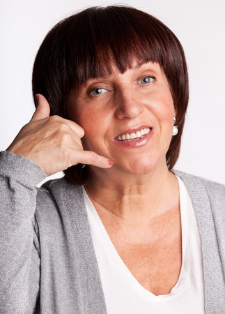 Woman, showing a sign of call photo