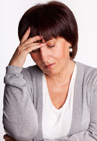 one mid adult woman only: Sadness mature woman. Isolated on gray Stock Photo