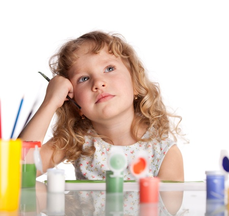 girl thinking: Littl child, drawing paint. Isolated on white Stock Photo
