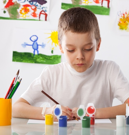 child drawing: Child on a drawing class