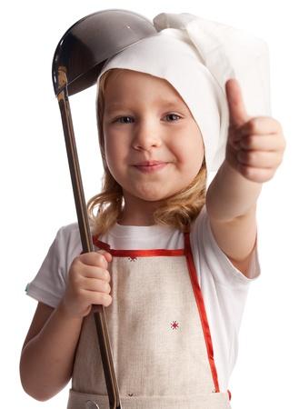 niños cocinando: Little Chef con cuchara aislado en blanco Foto de archivo