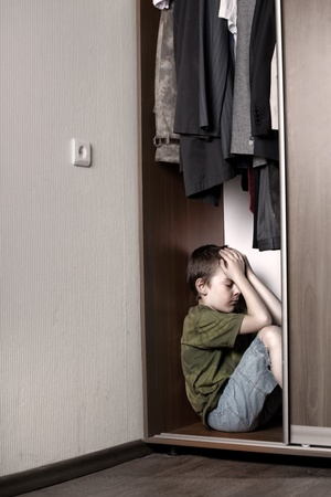 1 boy only: Sad boy, hiding in the closet at home