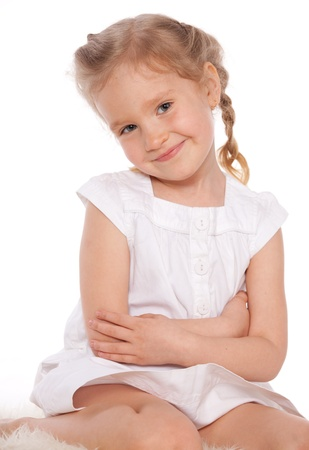 little girl sitting: Little girl isolated on white Stock Photo