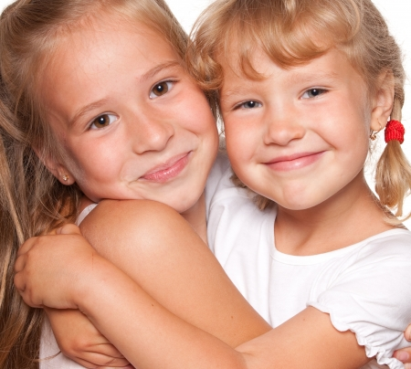 2 persons only: Happy embracing children isolated on white Stock Photo