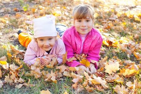 Happy kid in autumn park photo