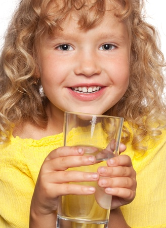 Child with a glass of water isolated on white photo