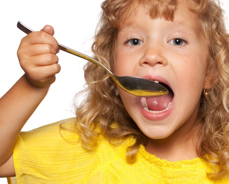 girl open mouth: Child with spoon isolated on white