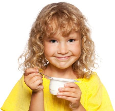 little girl eating: Little child eating yogurt Stock Photo