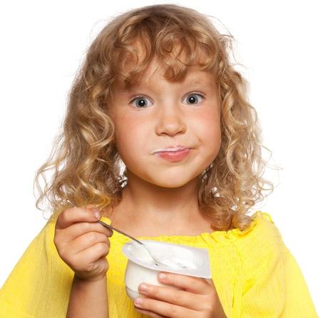 kids eating healthy: Little child eating yogurt Stock Photo