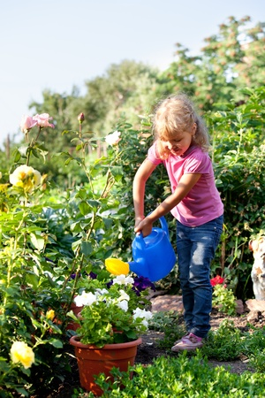 watered: Child watered from watering the flowers in the garden