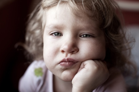 Sad little child looking at camera Stock Photo - 12466274