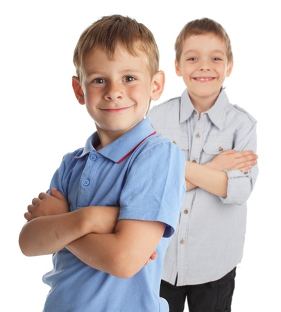 only 2 people: Smiling boy isolated on white