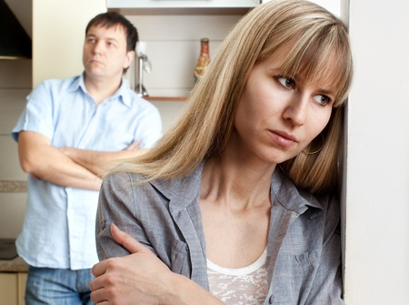 between: Conflict between man and woman at home Stock Photo
