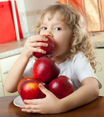 Happy girl with apples at home photo