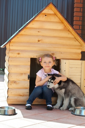 Child with a dog on the kennel photo