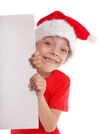 Child in a Christmas hat and the form in hands isolated on white photo