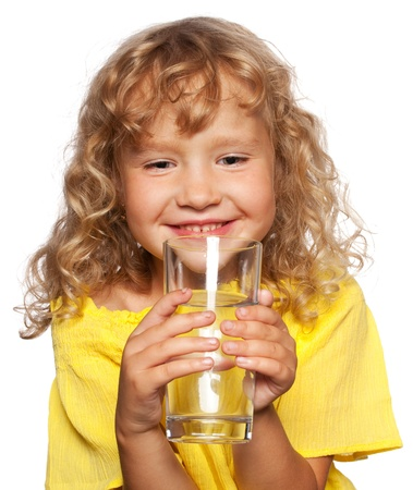only 1 girl: Child with a glass of water isolated on white