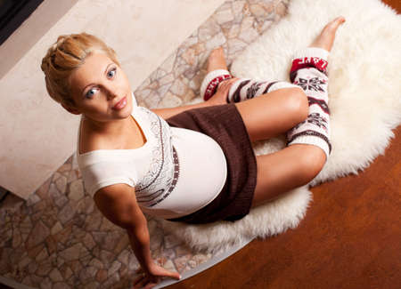 gaiters: Beautiful young pregnant woman at home Stock Photo